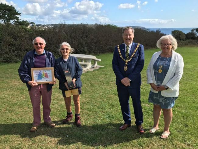 The Mayor, Councillor Steve Eva, presented the 2019/20 Spirit of Falmouth Award to Tony Hallam and Lynn Newsham for their work with Boscawen Fields Action Group