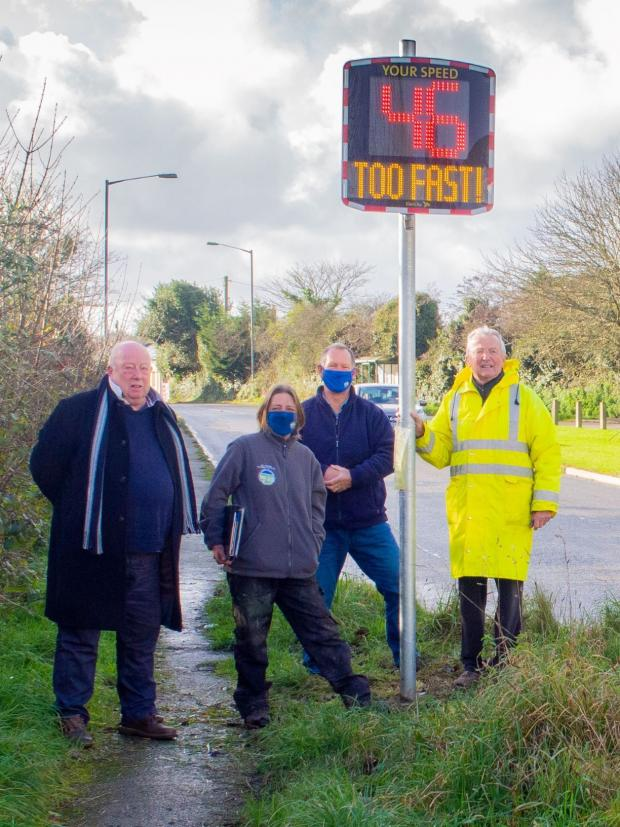 Falmouth Packet: Cornwall Councillor Pete Mitchell with Blen Barrett, Cllr Martin Ripper and Cllr Bill Forbes of St Agnes Parish Council with one of the new signs