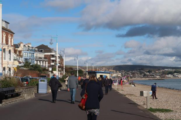 Falmouth Packet: People walking along Weymouth seafront during the third national lockdown