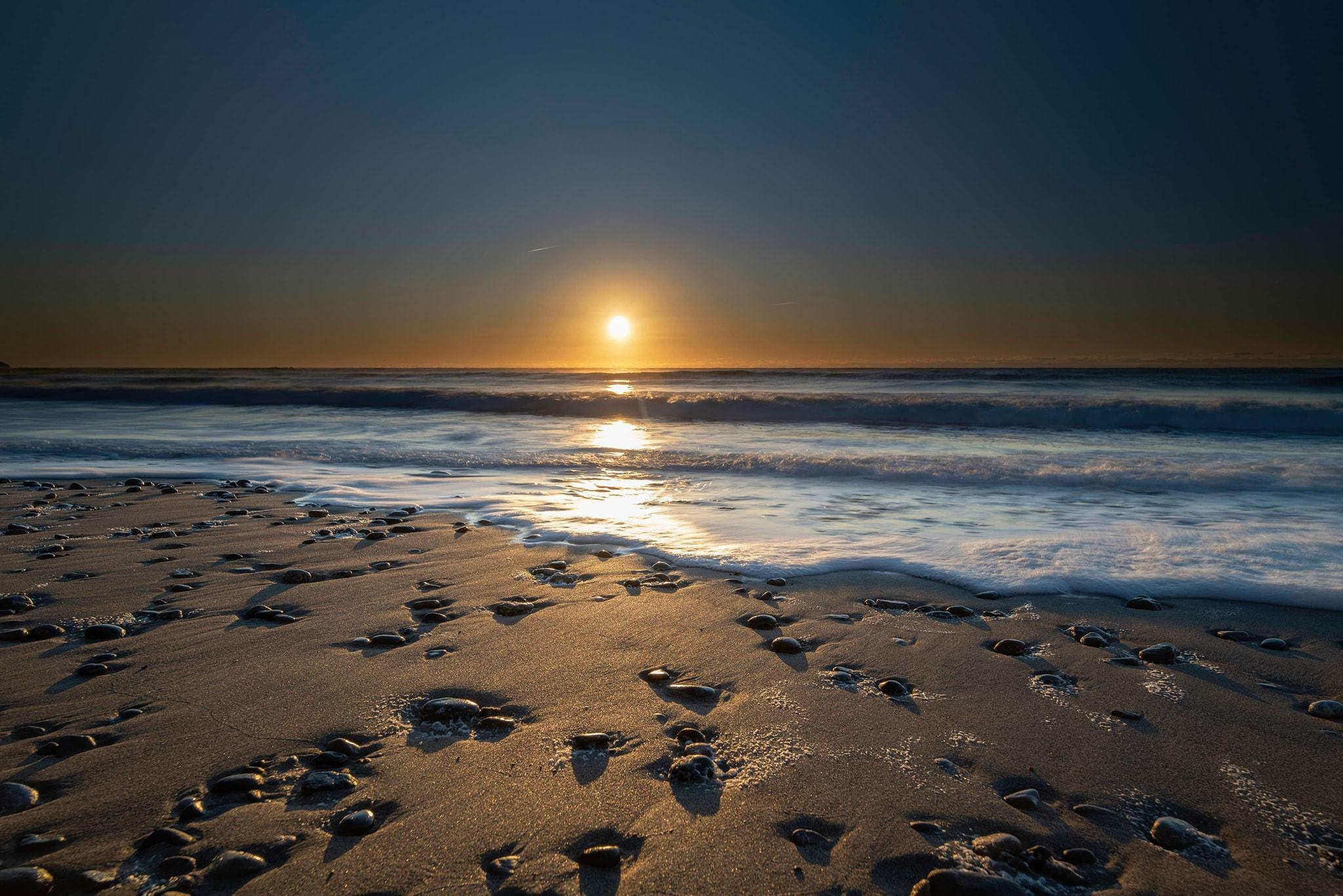 Beach sunset, by Steve Brickstock