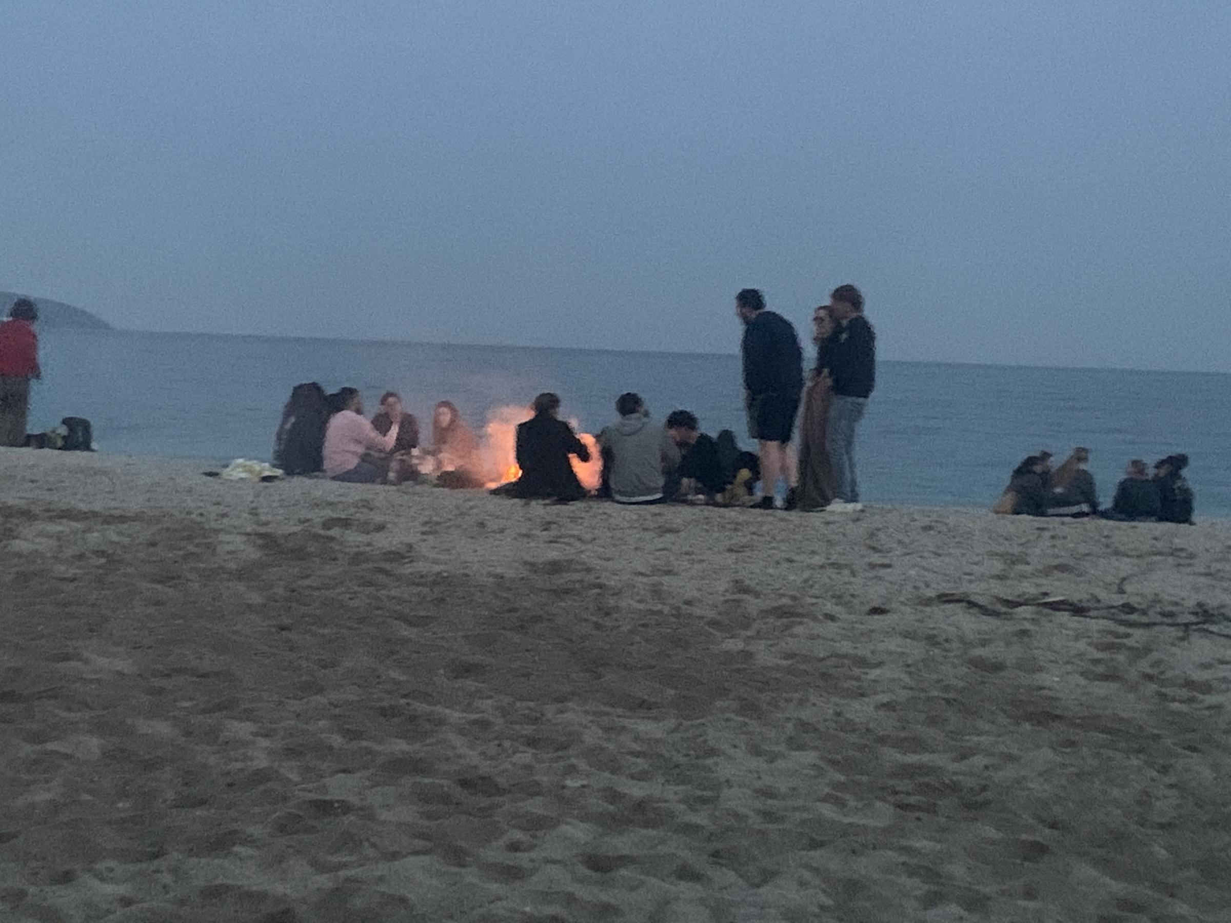 People lighting fires on the beach on Sunday