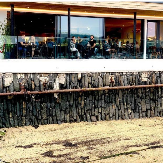 """Falmouth Packet: Simon Clark explained: """"We're operating off of our decking which is all outdoor, we have a limited seating area there and we're asking our customers to buy a table."""""""