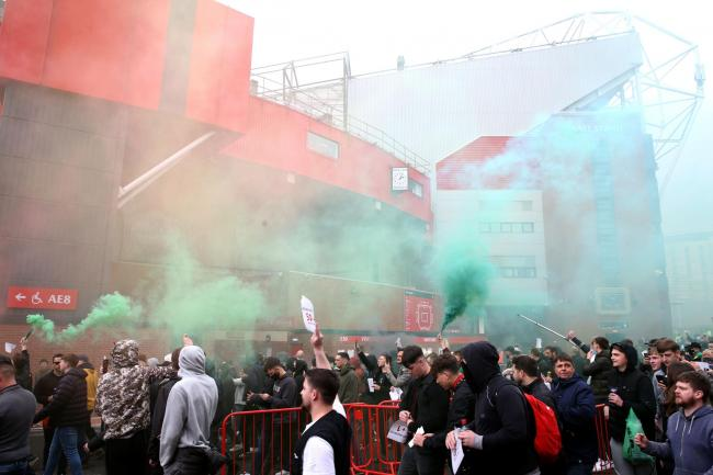 Manchester United fans protest against the club's owners outside Old Trafford on Sunday