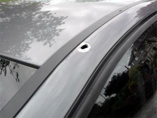 Falmouth Packet: DAMAGE:The 'bullet hole' left in the bodywork of the car in which Katie Higgins was travelling