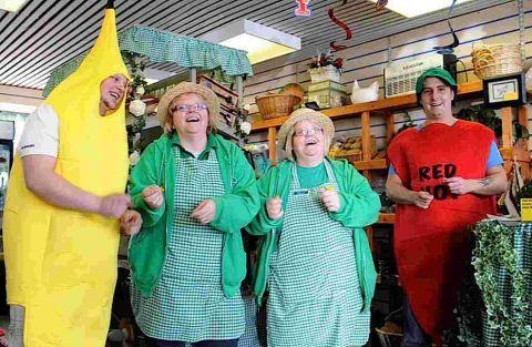 Sisters Debbie James and Paula Nicholls of Fruit & Veg 4 U with a giant banana and tomato