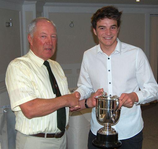 Hayden Van Reijn (right) receives the Dickie Robertson young player of the year trophy from chairman David Rickard