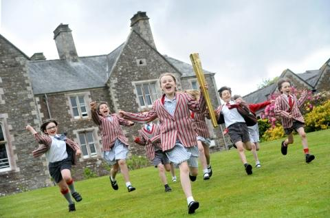 Olympic torch visits Polwhele House school