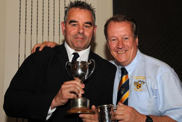George Pattison from Helston (left) receives his award for being the top marked referee from league chairman Mark Hayman