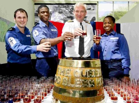 Culdrose crews drink a tot of rum on the Queen's orders
