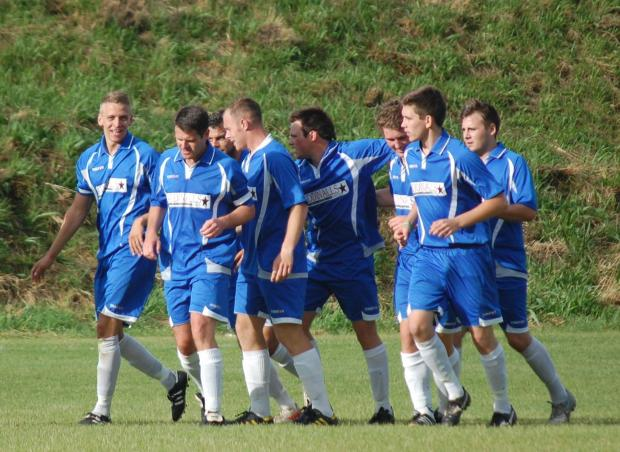 Helston Athletic players congratulate Liam Eddy on getting the third goal against Falmouth Town Reserves