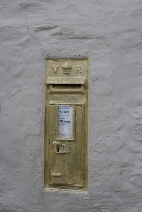 The postbox painted gold at the Pandora Inn