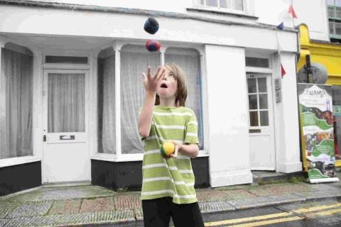 Having a go at juggling in Lower Market Street