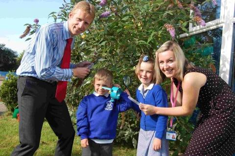 Headteacher Shaun Perfect and new acting deputy head Claire Dornan help year one pupils Thomas and Amy look for bugs