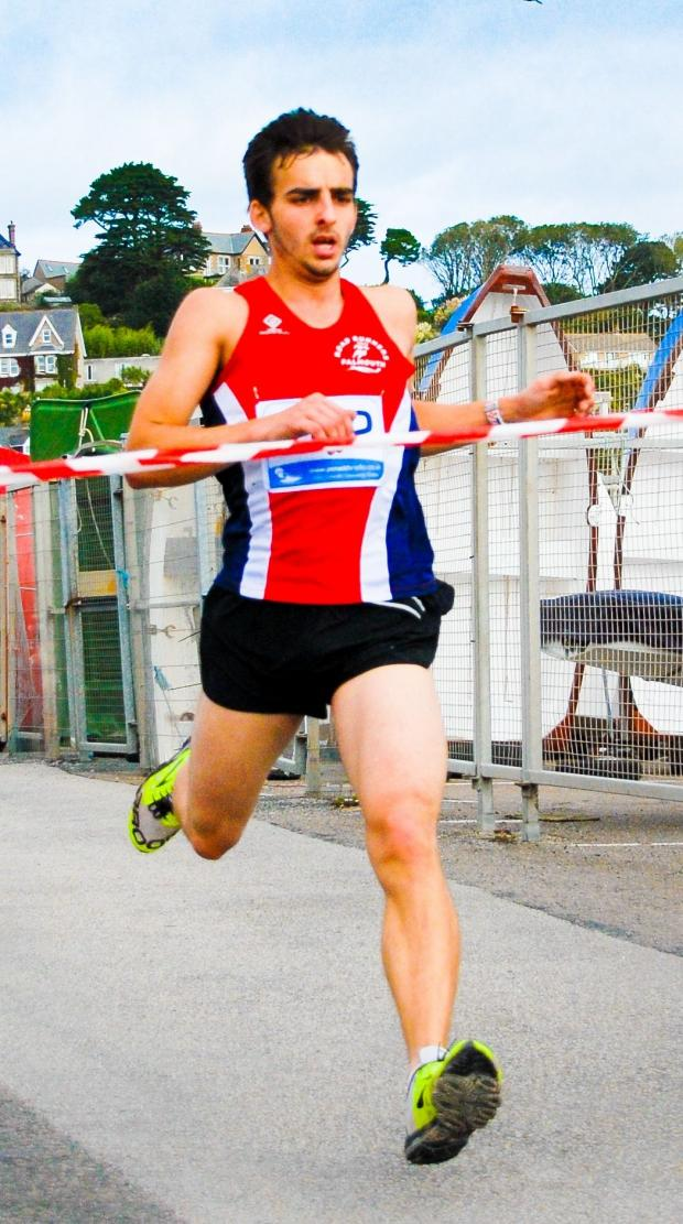 Falmouth Road Runner Richard Dalton crossing the finish line on Sunday