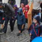 A torrential downpour disrupted the end of the parade