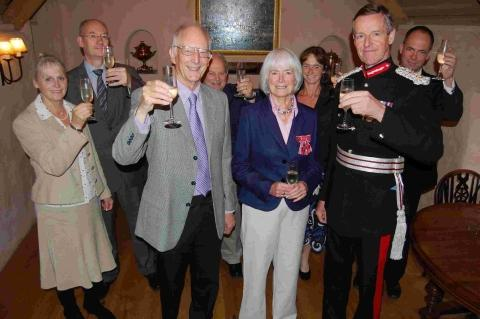 Jan Sadler presented with her MBE by the Lord Lieutenant of Cornwall Colonel Edward Bolitho in front of her husband Colin Sadler and family members