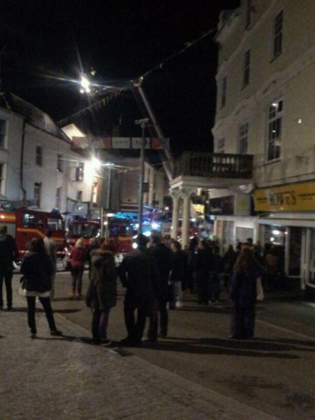 Crowds gather in Market Strand to watch the fire unfold. Picture Michelle Kent/Twitter.