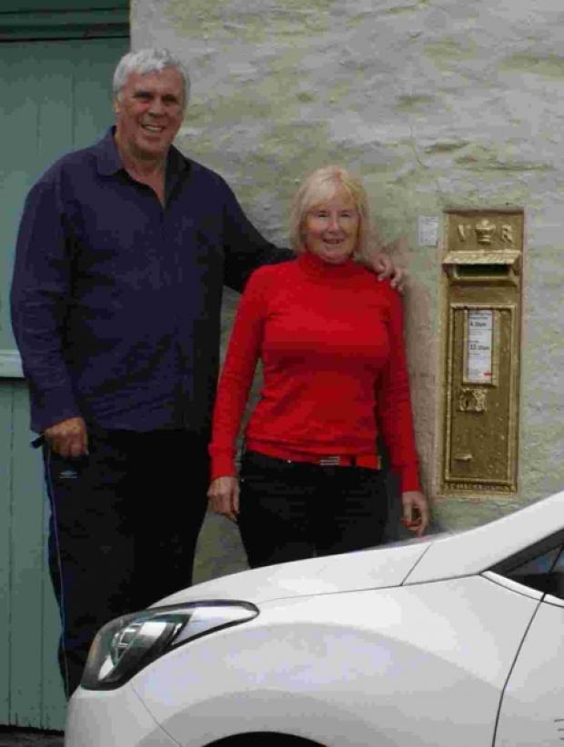 Chris and Christine Power by the gold postbox for Olympic sailor Ben Ainslie at the Pandora Inn.