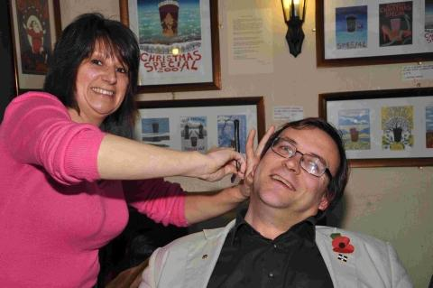 Former mayor John Boase goes under the knife at the Blue Anchor in preparation for growing a 'Movember' moustache