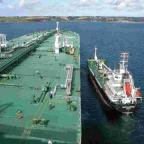 Falmouth Packet: A bunkering tanker leaves a very large crude carrier (VLCC) in Falmouth Bay 	Picture: DAVID BARNICOAT