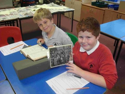 Penryn pupils take a closer look at 80-year-old photographs and documents.