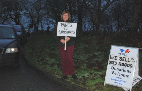 Pants Matters charity founder Jeannette Preston stands with a protest placard outside her store at Ponsharden.