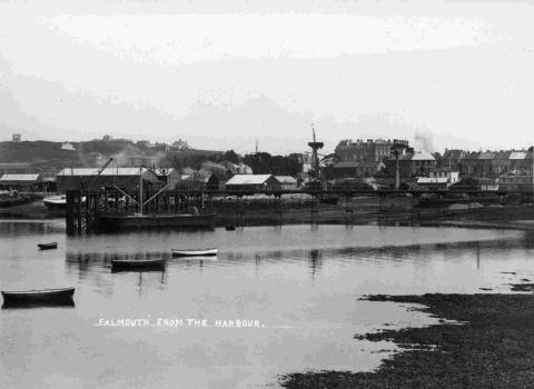 An image of The Bar and Submarine Pier, with The Falmouth Hotel in the background, taken circa 1900.