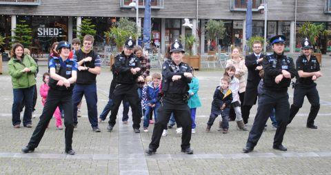 'Gangnam' Gary (centre) and fellow police officers dance for the upcoming video.