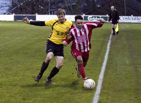 Falmouth Town's Lee Jeffries Challenges Saltash forward Dimitri Kanakh PHOTOS: Sam Barnes/Cartel