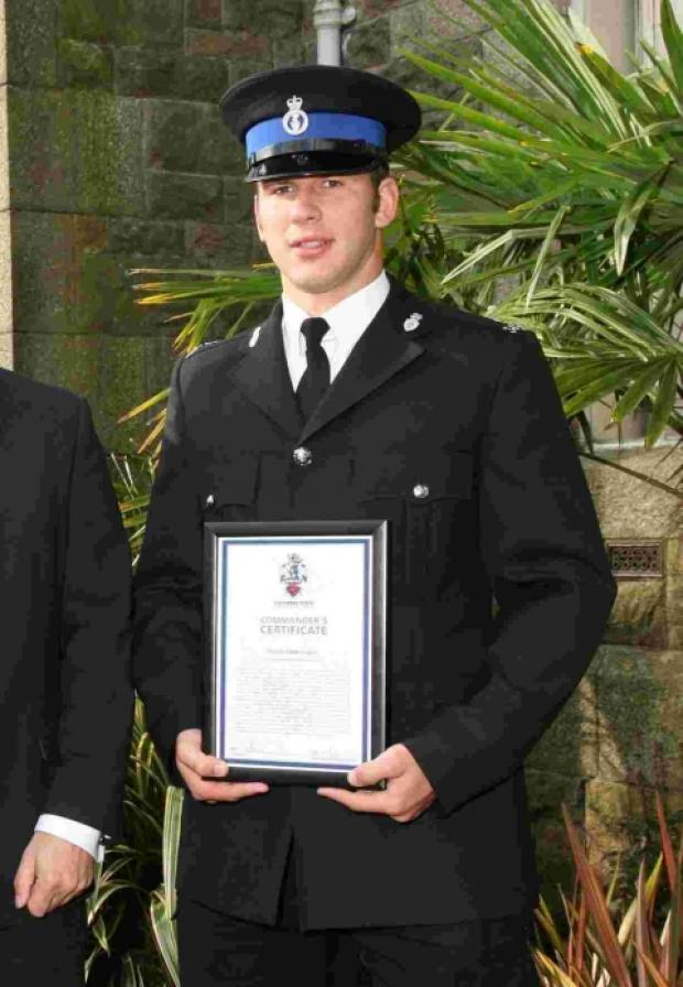 Police Community Support Officer Lewis Vague, pictured right at an awards ceremony
