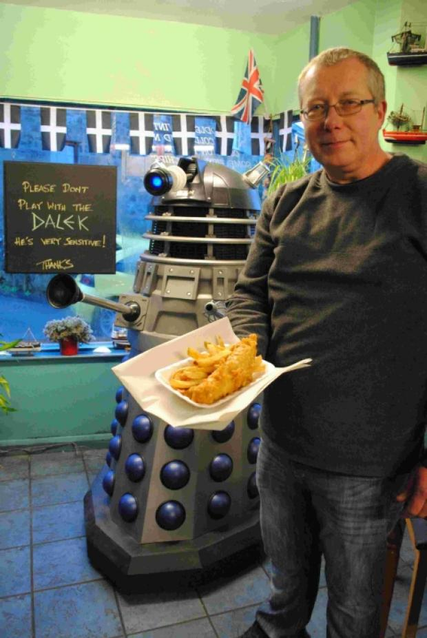 Marc Stonham with his Dalek that takes pride of place at Nettles in Helston fish and chip shop