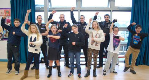 Sgt Gary Watts and the team dance 'Gangnam Style' with year six Devoran pupils
