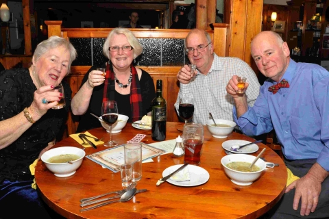 Falmouth Packet: June Nance, Carole Elliott, Steve Barber and Graham Barber toast the haggis.