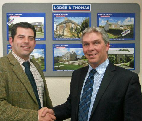 Ross Collins (left) is welcomed by Andrew Body, senior partner of Lodge & Thomas (right).