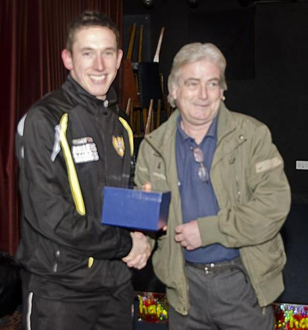 Falmouth Packet: Ross Pope (left) being presented his award by another Falmouth legend, Neil Phillips