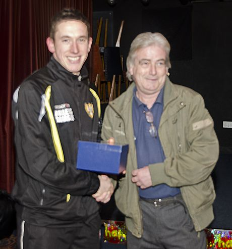 Ross Pope (left) being presented his award by another Falmouth legend, Neil Phillips