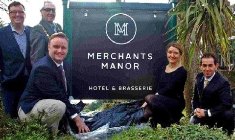 Owners Nick Rudlin and Sioned Parry-Rudlin, Falmouth's mayor Geoffrey Evans, general manager Neil Slade, and assistant general manager Zafer Kuru unveil the new hotel sign