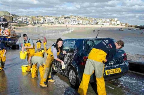 Crew, shorecrew, wives and girlfriends washing cars. Credit: RNLI/Derek Hall