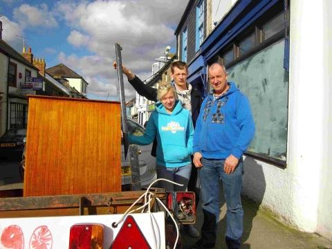 Leah Lawley, Gav Price and Martin Lawley help move stock into the new shop.