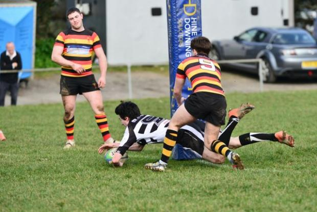 Falmouth scrum half Billy Burner goes over for a score