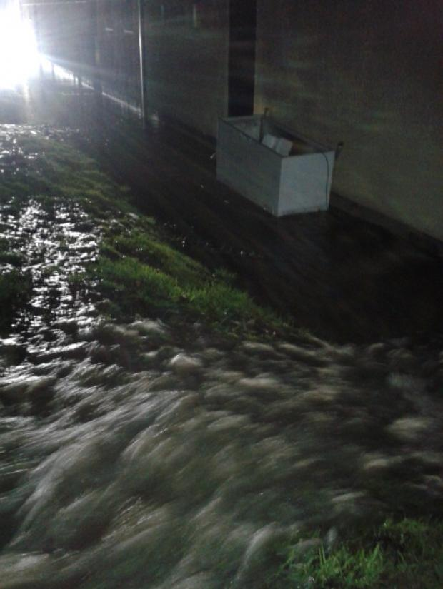 Water was gushing out near this building on the Kernick Industrial Estate yesterday evening