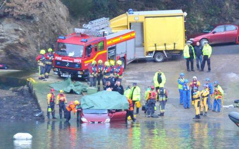 The car, covered in a tarpaulin, is recovered at the King Harry Ferry slipway. Photos: Cornish Photo News