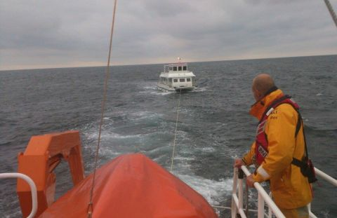 A twin-hulled motor boat is towed back by Penlee all-weather lifeboat. Credit: RNLI/Penlee