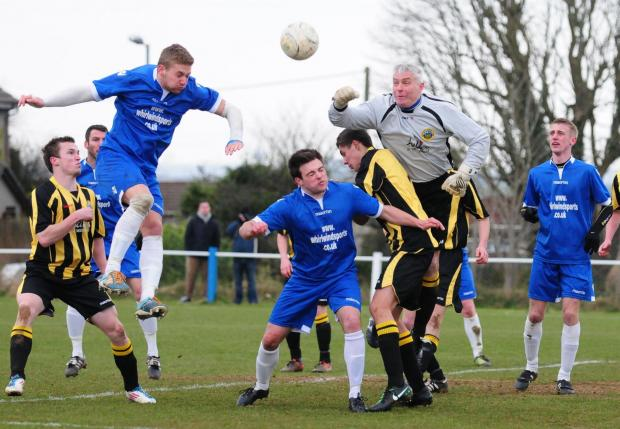 Port player manager Dennis Annear, pictured punching the ball clear against Helston last season, says signing a new keeper is a priority after Christmas