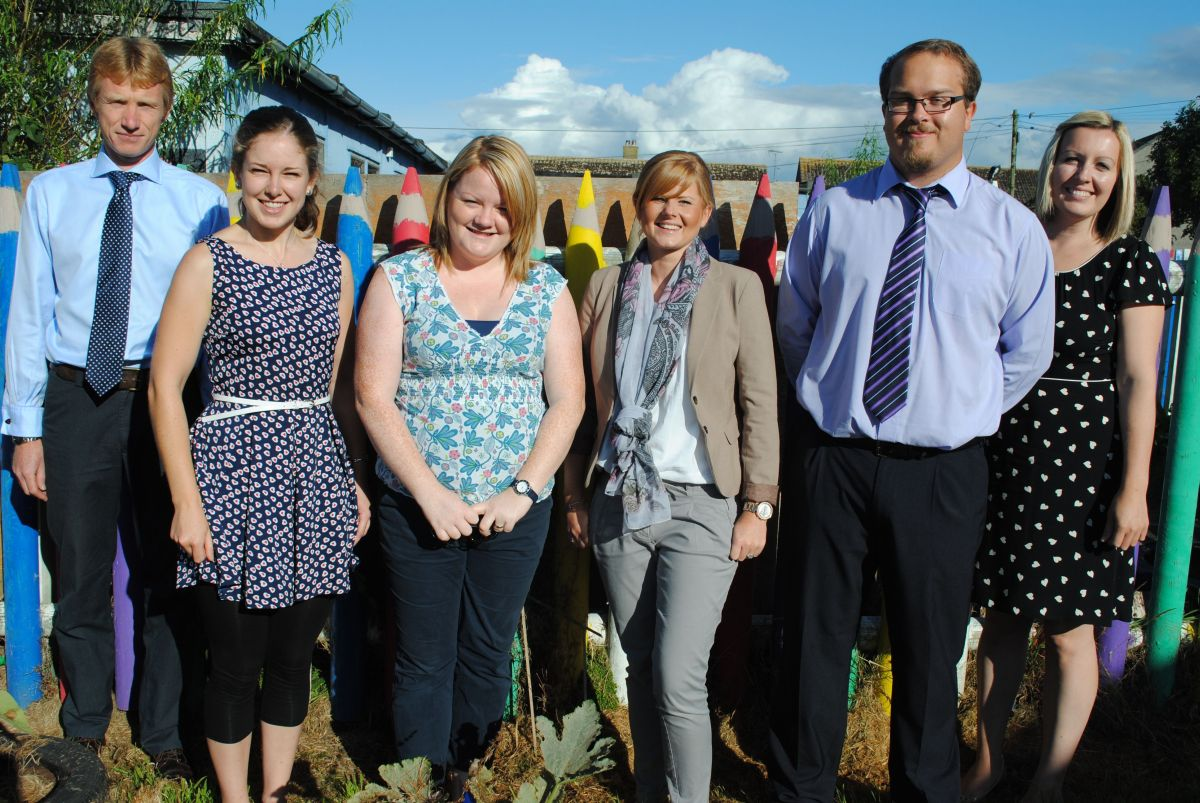 Headteacher Shaun Perfect and deputy head Claire Dornan (far left and right) welcome new teachers Suzanne Bray, Joanne Le Good, Laura Roadley and David Raynor.