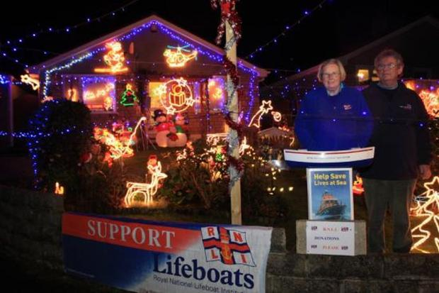 Falmouth Packet: Mick and Margaret French with their Christmas lights for the RNLI