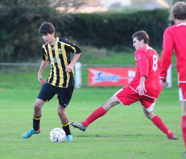 Falmouth Packet: Liam Hunter takes on a defender