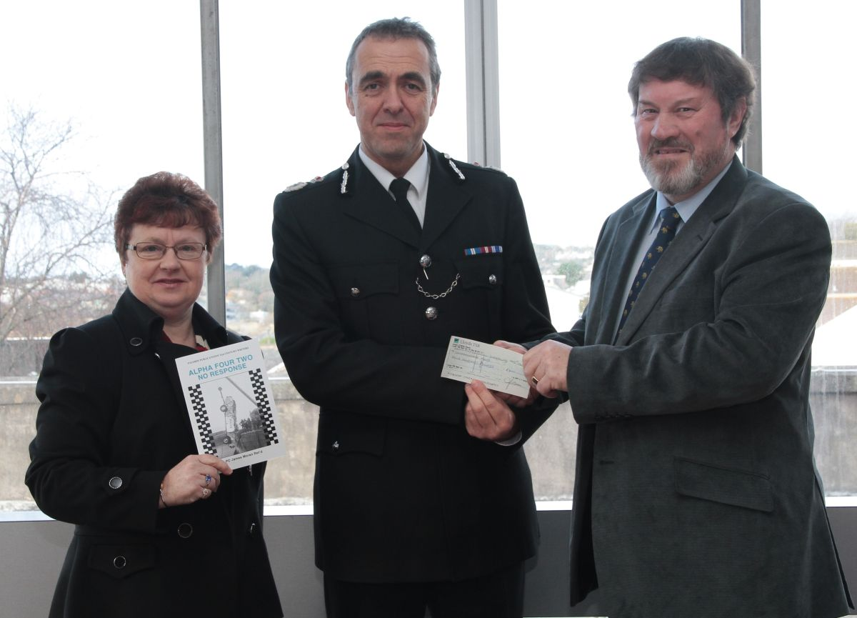 Police compassionate fund donation from book focusing on death of two police officers in Porthleven harbour