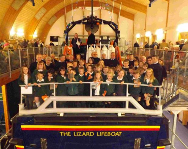 All aboard for Christmas carolaire on Lizard lifeboat: PICTURES
