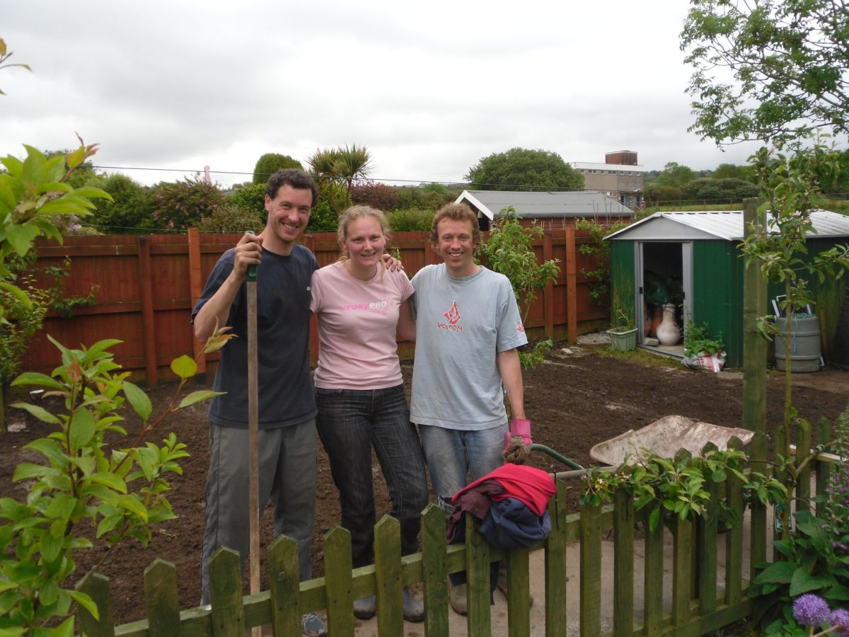 Some of the volunteers with Irene Kemp's garden after the makeover.